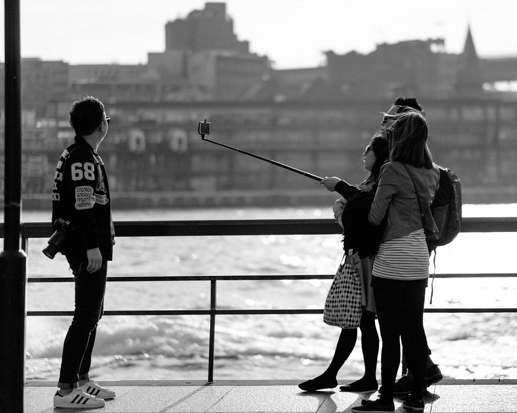 photographer vs selfie stick